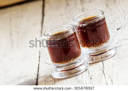 Dark beer in an old-fashioned cups, selective focus