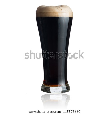 Dark beer in glass isolated on white - stock photo