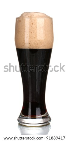 dark beer poured into a glass isolated on white - stock photo