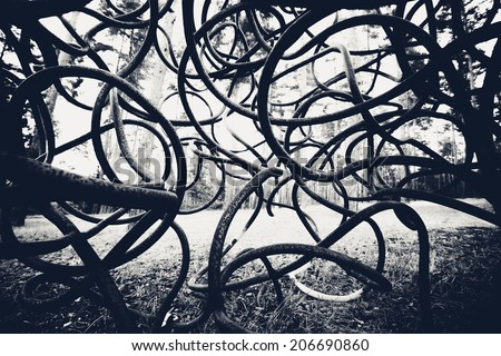 dark black and white curved rods background - stock photo
