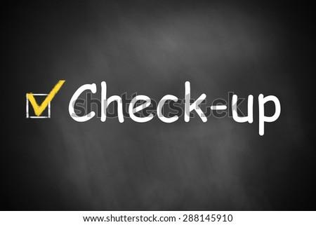 dark black chalkboard check-up checkbox marked - stock photo