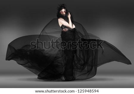 Dark Black Fashion Motion Portrait Of A Edgy Young Beautiful Caucasian Brunette Model In Gorgeous Gothic Lace Dress And Make-up - stock photo