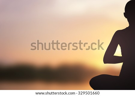 dark black silhouette of asian woman in yoga over blurred sunset golden sky background:female in yoga pattern exercise for healthy:concentrate zen female concept.calmness feeling/powerful conceptual. - stock photo