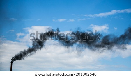 Dark black smoke from the chimney - stock photo