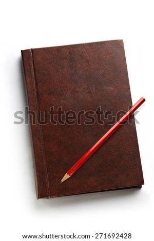 Dark blank notebook with red pencil on it - stock photo