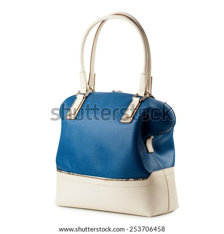 Dark blue and beige female handbag isolated on white background.