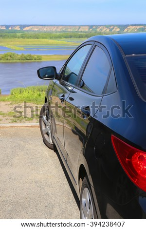 dark blue car at high river bank