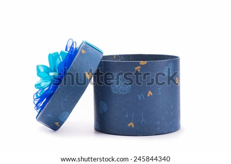dark blue circular and heart decorated gift box isolated on white background  - stock photo