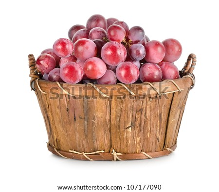 Dark blue grapes in a wooden basket isolated.jpg - stock photo