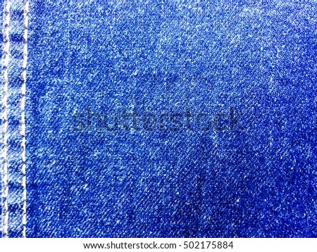Dark blue jeans texture. Clothes background,blur,out of focus