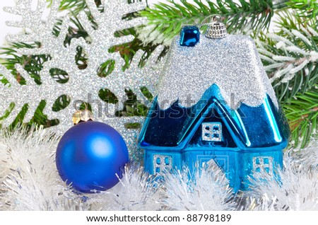 Dark blue New Year's ball and toy small house  - stock photo