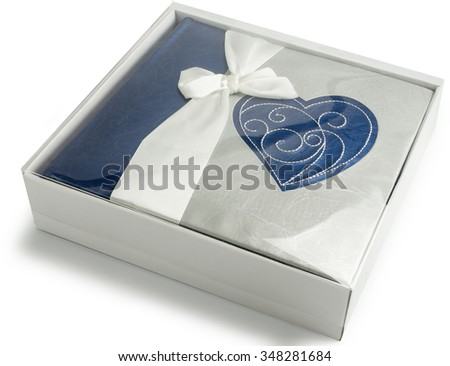 Dark blue photo album with heart in gift box isolated on white background. Present of Valentines Day - stock photo