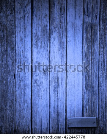 dark blue plank with small blank sign for text - stock photo
