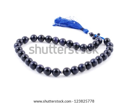 Dark Blue Rosary Beads, from gem on white background - stock photo