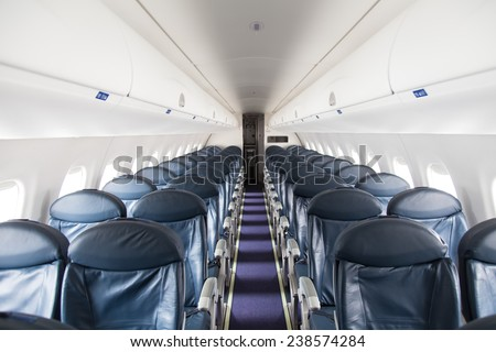 Dark Blue Seats in a Empty Jet Airplane - stock photo