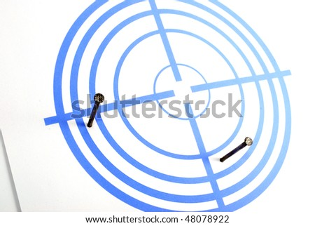 Dark blue target with concentric circles and nails