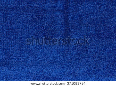 Dark blue towel texture. Background and texture. - stock photo
