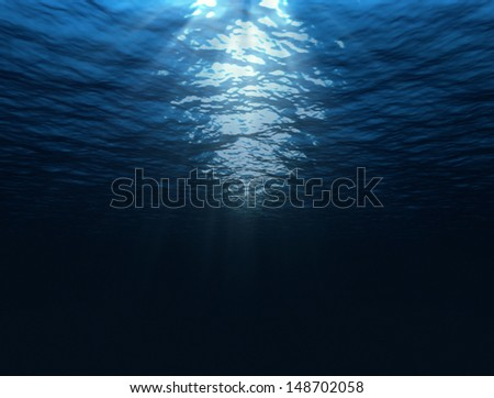 dark blue under water image with sun rays  - stock photo