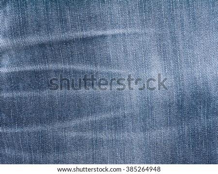 Dark blue washed faded denim fabric background - stock photo