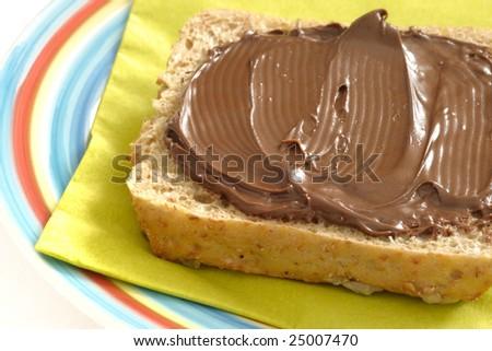 Dark bread with chocolate cream - stock photo