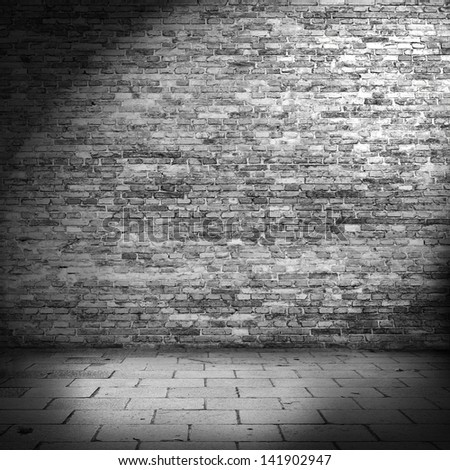 dark brick wall background in basement with beam of light