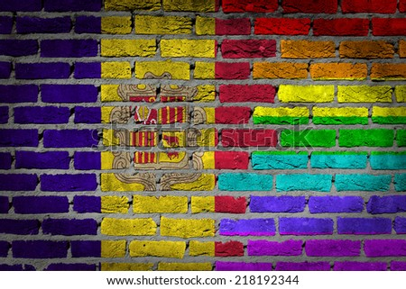 Dark brick wall texture - country flag and rainbow flag painted on wall - Andorra