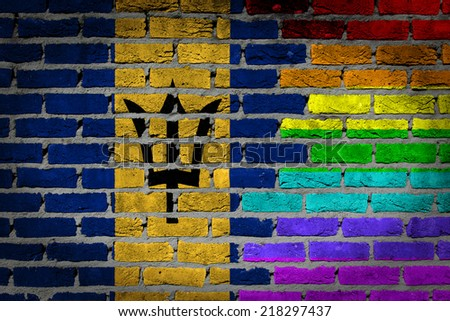 Dark brick wall texture - country flag and rainbow flag painted on wall - Barbados