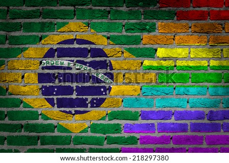 Dark brick wall texture - country flag and rainbow flag painted on wall - Brazil - stock photo