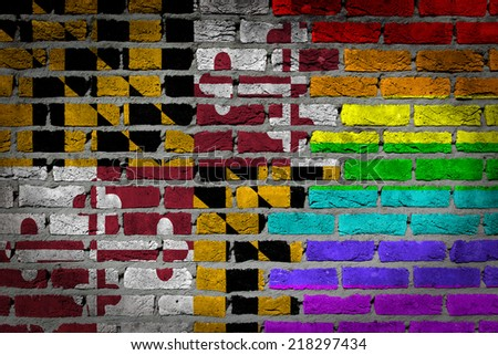 Dark brick wall texture - country flag and rainbow flag painted on wall - Maryland - stock photo