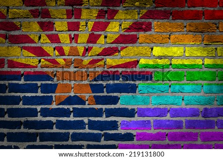 Dark brick wall texture - coutry flag and rainbow flag painted on wall - Arizona - stock photo