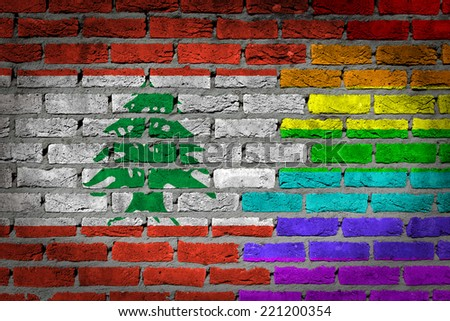 Dark brick wall texture - coutry flag and rainbow flag painted on wall - Lebanon - stock photo