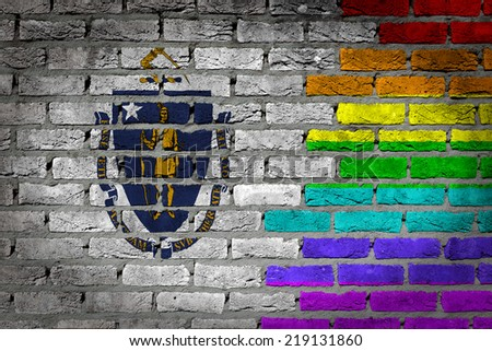 Dark brick wall texture - coutry flag and rainbow flag painted on wall - Massachusetts - stock photo