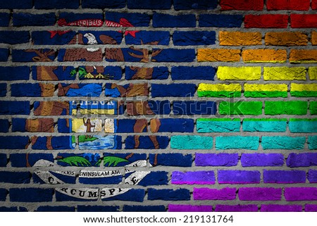 Dark brick wall texture - coutry flag and rainbow flag painted on wall - Michigan - stock photo