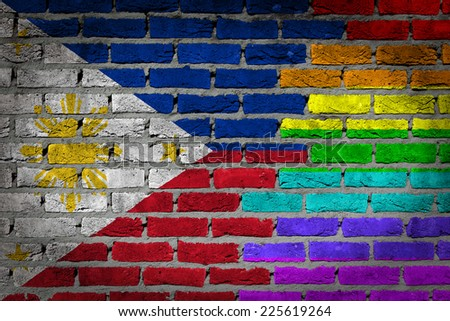 Dark brick wall texture - coutry flag and rainbow flag painted on wall - Philippines - stock photo