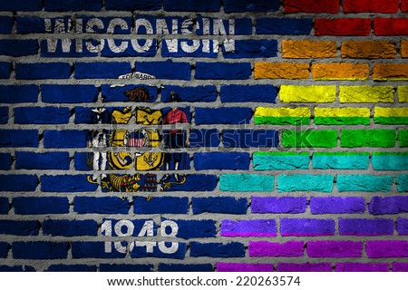 Dark brick wall texture - coutry flag and rainbow flag painted on wall - Wisconsin - stock photo