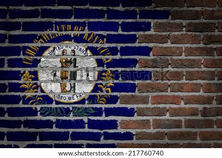 Dark brick wall texture - flag painted on wall - Kentucky - stock photo