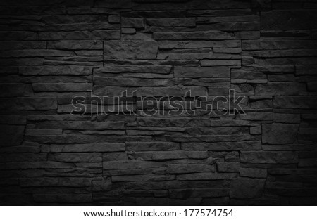 Dark brick wall texture, great for grunge backgrounds. - stock photo