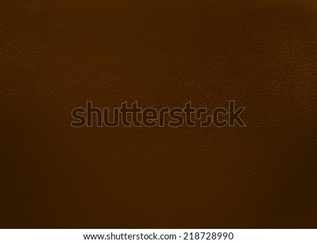 Dark brown colored leather texture background - stock photo