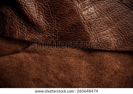 Dark Brown Leather and Suede for Concept and Idea Style of Fine Leather Crafting, Handcrafts Workspace, Handmade Leather Handcrafted, Leather Worker. Background Textured and Wallpaper. Vintage Rustic. - stock photo