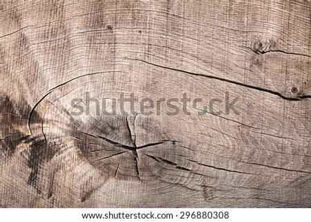 Dark brown old wooden board, closeup background texture with cracks and knot