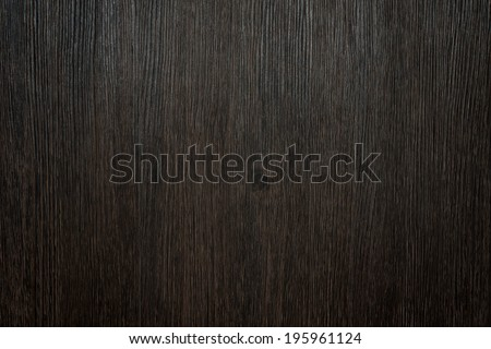 Dark brown rustic background made of a clean processed wooden surface - stock photo