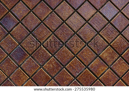 Dark brown smooth stone mosaic wall floor - stock photo