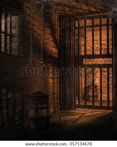 Dark cells in an old castle dungeon - stock photo