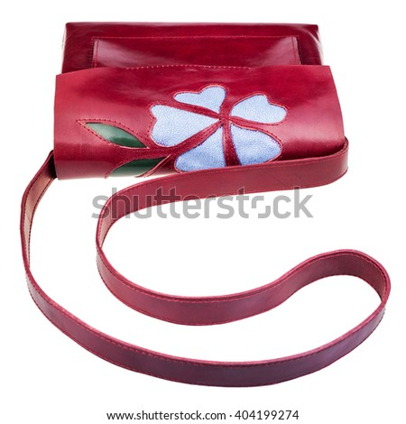 dark cherry color handbag decorated by flower applique isolated on white background
