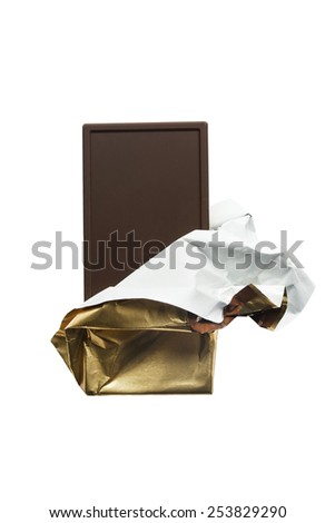 Dark chocolate bar in golden envelope on white background - stock photo