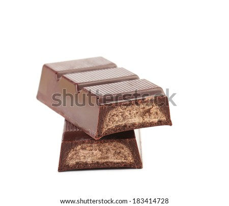 Dark chocolate bar with sweet creamy filling. Isolated on a white background.