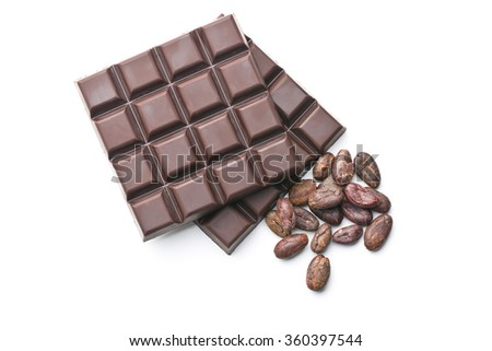 dark chocolate bars and cocoa beans on white background - stock photo