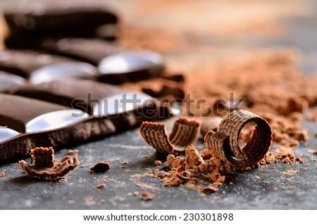 Dark chocolate chips and powder - stock photo