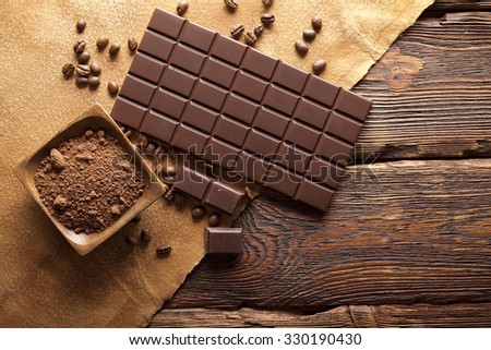 Dark chocolate, cocoa and coffee grains - stock photo