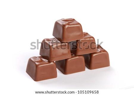 dark chocolate construction on white background - stock photo